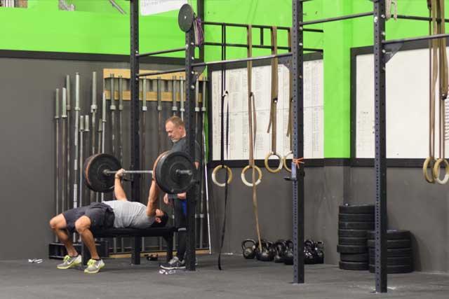 Guys doing bench presses