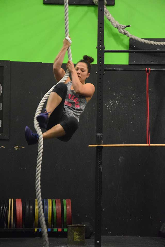 Woman rope climbing