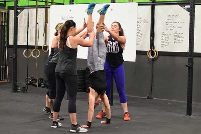 Groups of ladies practicing handstands