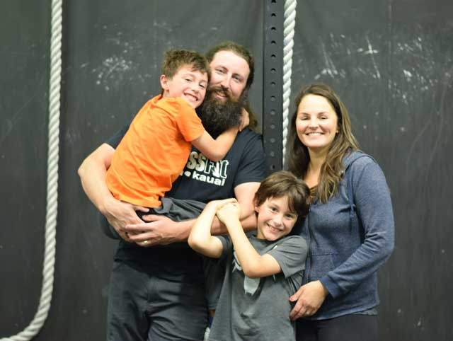Lynnwood Crossfit owners and trainers family picture